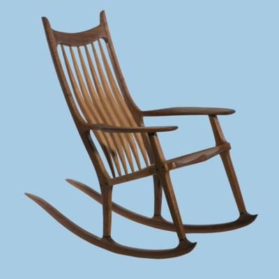 ROCKING CHAIR EN NOYER PAR C. CLAEYS